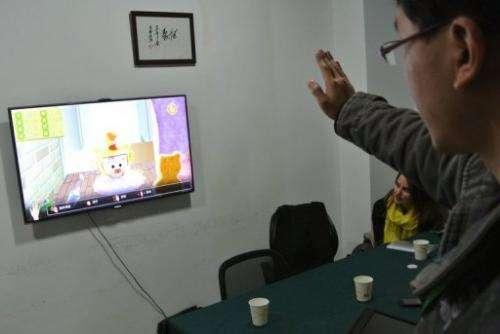 Developer tests a game for children in his office in Chengdu, southwest China's Sichuan province, on December 12, 2012