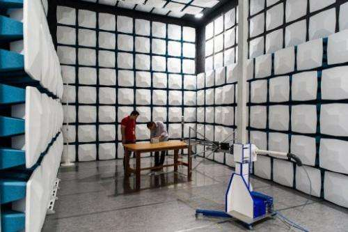 Engineers test an electromagnetic wave inside the anti-echo chamber at Eldorado research institute in Campinas, Brazil