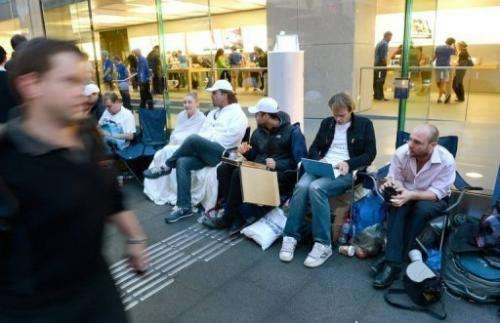 Gadget lovers wait in line in for the new iPhone 5