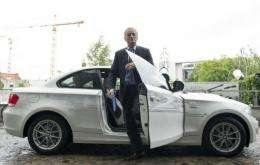 German Transport Minister Peter Ramsauer gets out of an E-drive BMW electric car as he arrives for a press conference