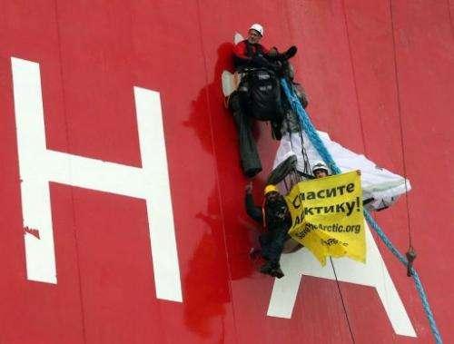 Greenpeace Executive Director Kumi Naidoo (bottom) gives a thumbs up