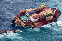 Half of the grounded container ship 'Rena' is seen in the Bay of Plenty
