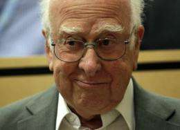 Higgs received a standing ovation as he arrived at the auditorium