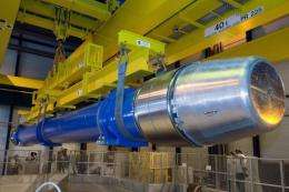 Image provided by CERN shows a large dipole magnet being installed into the Large Hadron Collider (LHC)