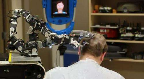 IAI's military robot acts like barber in charity role
