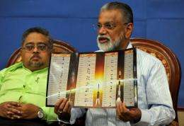 K. Radhakrishnan displays a brochure highlighting ISRO's 100th mission