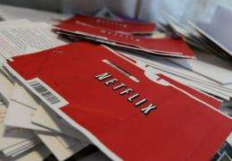Netflix envelopes sit in a bin with other mail