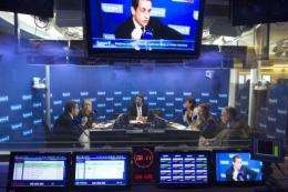 Nicolas Sarkozy (L) takes part in a radio show on the French radio station network Europe 1, in Paris