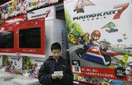 Nintendo posts loss on strong yen, weak sales (AP)