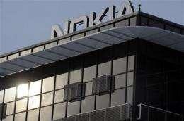 Nokia lowers profit outlook, shares nosedive (AP)