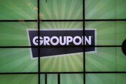 Online shopping deals giant Groupon on Monday posted a sound quarterly profit but saw its stock tumble nearly 20 percent