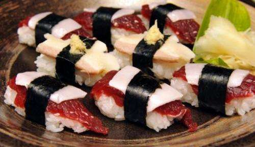Pieces of whale sushi, made from sliced minke meats, blubber and rice balls, are seen in Ayukawahama, on June 16, 2010