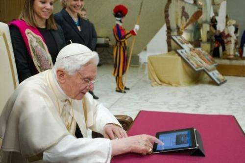 Pope Benedict XVI sends his first twitter message at the Vatican on December 12, 2012