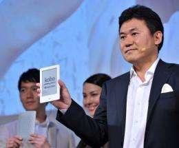 President of Japan's top online retailer Rakuten, Hiroshi Mikitani (R), introduces the