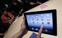 Report: Tablets helping improve news consumption (AP)