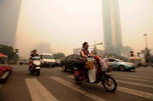 Residents rushed to put on face masks when they saw the haze in Wuhan on Monday