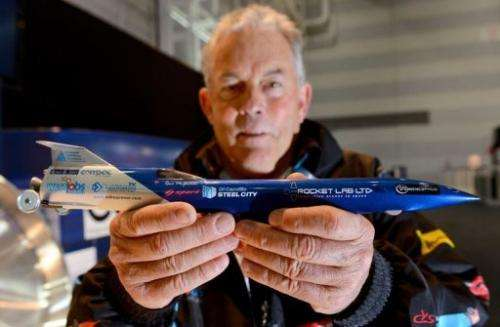 Rosco McGlashan holds a model of his rocket car that he and his team hope to use to break the land-speed record