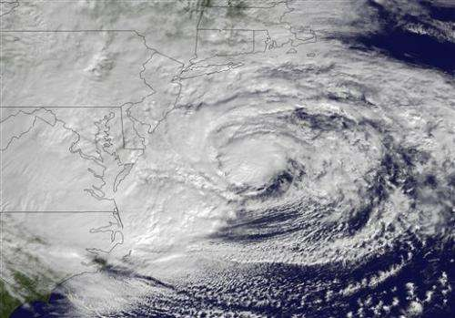 Sandy: Losing tropical nature, but gaining girth