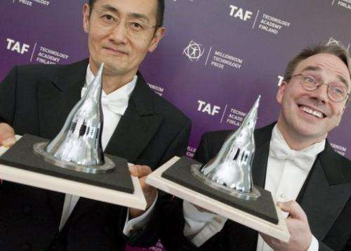 Shinya Yamanaka and Linus Torvalds (R) pose after being awarded the 2012 Millennium Technology Prize