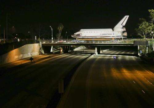 Shuttle inches toward retirement home at LA museum