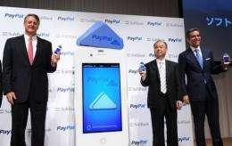Softbank president Masayoshi Son (C), eBay CEO John Donahoe (L) and PayPal president David Marcus