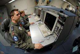 Soldiers sit in front of computers at the NATO airbase in Geilenkirchen in 2007
