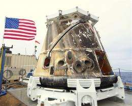 SpaceX capsule back on solid ground after flight