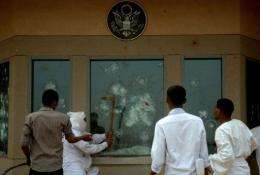 Sudanese protesters try to break into the US embassy in Khartoum during a protest against an amateur film mocking Islam