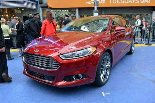 The 2013 Ford Fusion Hybrid at its introduction in New York's Times Square in September