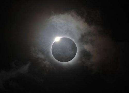 The Diamond Ring effect is shown following totality of the solar eclipse at Palm Cove in Australia
