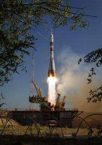 Three-man Soyuz crew departs for space station (AP)