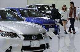 Toyota quarterly profit triples, raises forecast