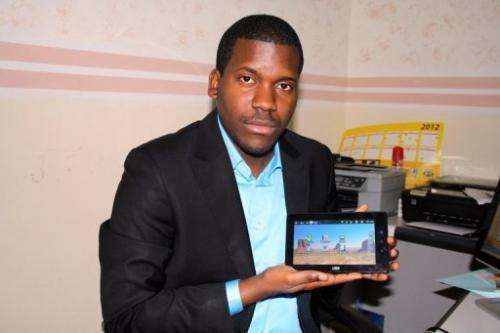 Verone Mankou displays the tablet he invented in the offices of his company, VMK, in Brazzaville on January 31, 2012