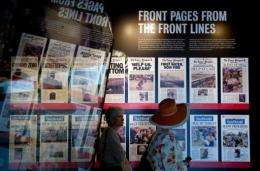Visitors tour front pages from The Times-Picayune newspaper in New Orleans as part of an exhibit at the Newseum in 2010