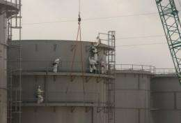 Workers construct water tanks at TEPCO's Fukushima Daiichi nuclear power plant