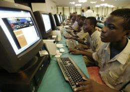 Young Ivorians learn how to use a computer