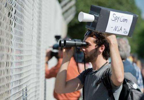 A man protests outside a US National Security Agency listening station in Darmstadt, Germany, on July 20, 2013