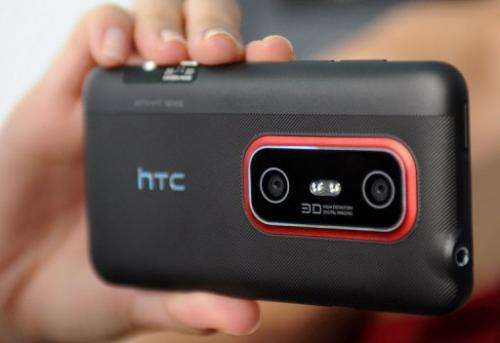A model displays a HTC smartphone in Taipei on August 17, 2011