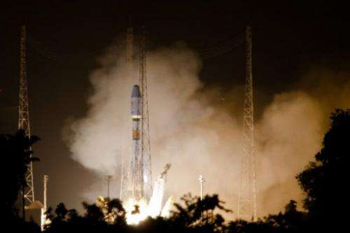 A Soyuz rocket lifts off on December 16, 2011 from Europe's space base in Sinnamary, 12km from Kourou
