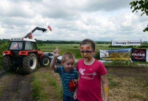 Children play near where oil company Chevron plans to put a shale gas drilling rig, Zurawlow, Poland, June 11, 2013