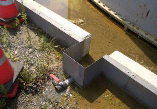Contaminated water from a leaking water tank is shown at TEPCO's Fukushima nuclear power plant on August 19, 2013