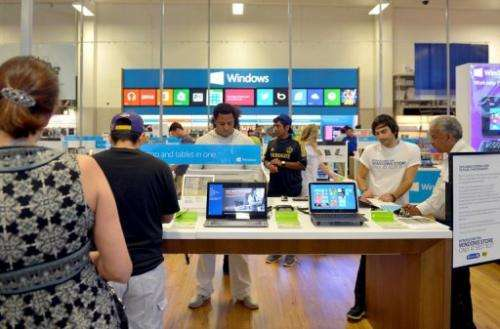 Customers check out Windows 8 from Microsoft a new Windows Store at Best Buy on August 7, 2013 in Los Angeles