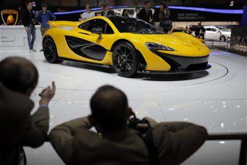 Ferrari and  McLaren unveil hybrid supercars