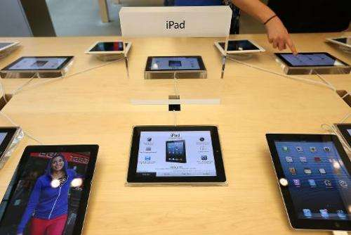 Fourth generation Apple iPads are seen on display at an Apple store on February 5, 2013 in San Francisco, California