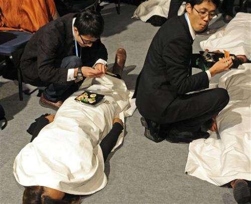 Japan dials back climate change emissions target