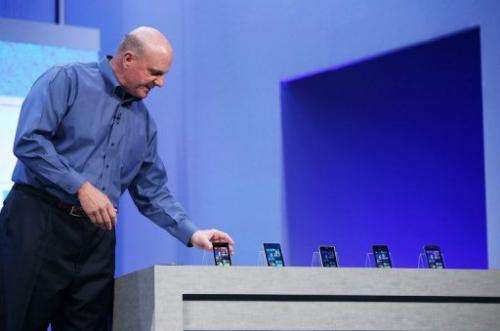 Microsoft CEO Steve Ballmer looks at a display of Windows phones on June 26, 2013 in San Francisco