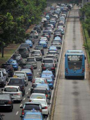 Motorists are trapped in the rush-hour gridlock in Jakarta, on October 22, 2013