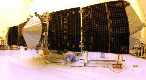 NASA's Mars Atmosphere and Volatile Evolution (MAVEN) spacecraft with solar panels extended is checked by technicians on Septemb
