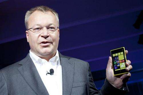 Nokia cuts losses but sales continue to plummet