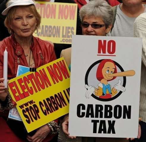 Protesters rallyin Sydney against plans to introduce a carbon tax, on July 1, 2011